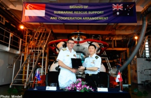 RAN's Chief of Navy Vice-Admiral Ray Griggs (left) and RSN's Chief of Navy Rear-Admiral Ng Chee Peng (right) at the signing the Submarine Rescue Arrangement on board the RSN's submarine rescue and support vessel, MV Swift Rescue.