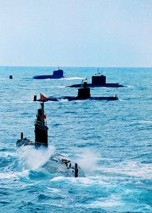 China's nuclear submarine conducts a drill with other submarines.