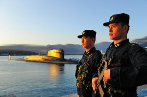 Soliders stand guard at the Qingdao submarine base