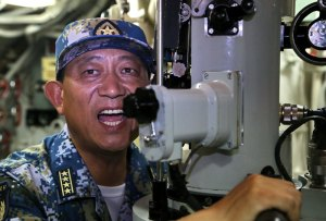 Sun Ruiqiang, a submarine captain, gives orders during a drill